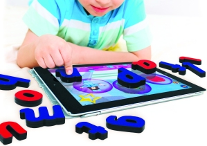 Child with iPad using Touchtronic Letters.